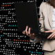 lady holding laptop in front of data